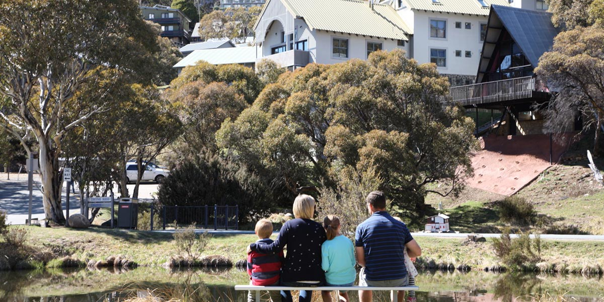 Family overlooking thredbo pond