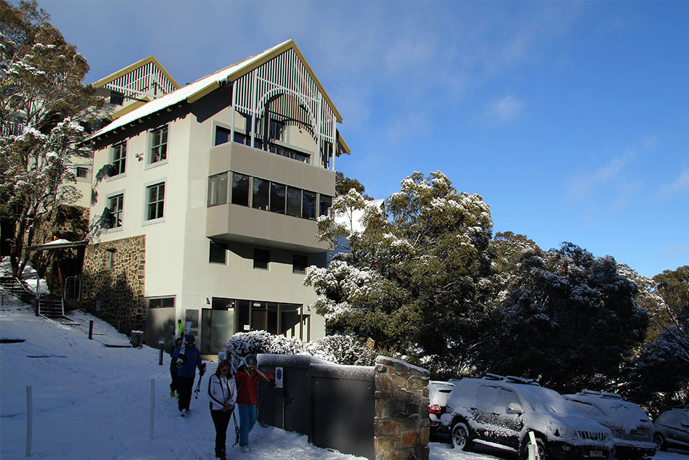 Skiers enjoying the short walk from Boali Lodge to Thredbo's chairlift